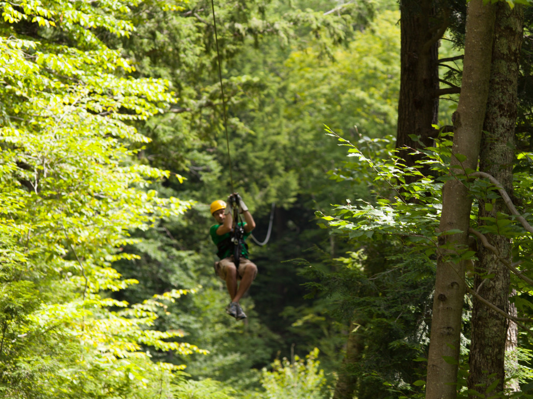 Flying through the forests of the Green Mountains during a Smugglers' Notch Canopy Tour.