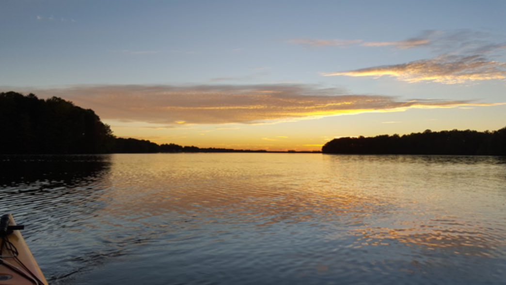 Although more populated than other area lakes, a paddler can still find a bit of solitude at sunset on Lake Norman