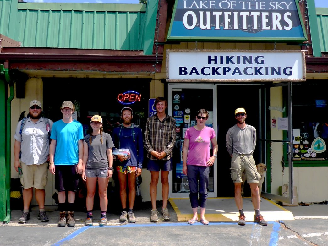 Pacific Crest Trail thru hikers pose in front of Lake of the Sky Outfitters before hitting the trail.