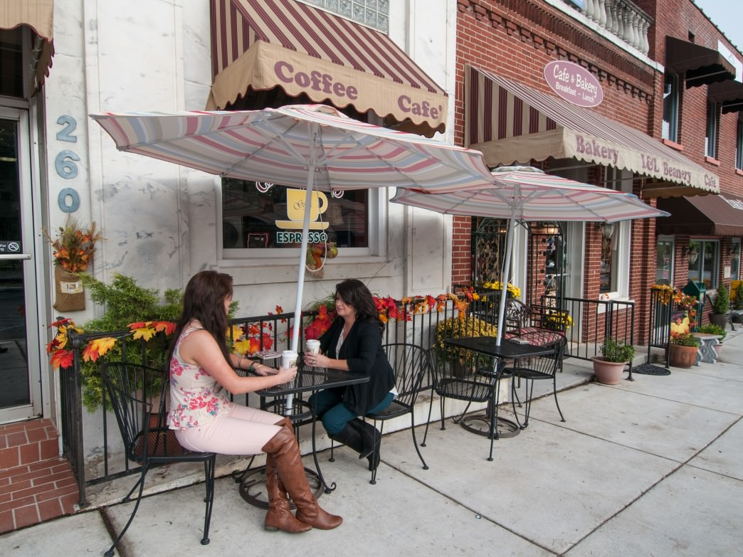 L&L Beanery has outdoor seating for a quick cup of coffee before the trails.