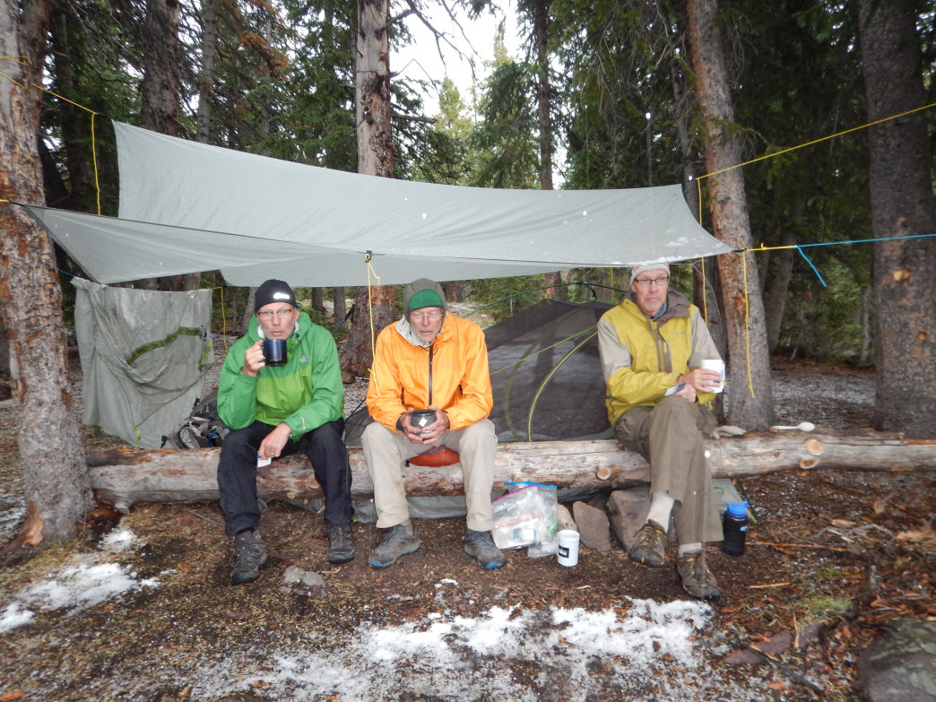 The crew huddled under a tarp at Carolyn Lake.     Polly Scotland