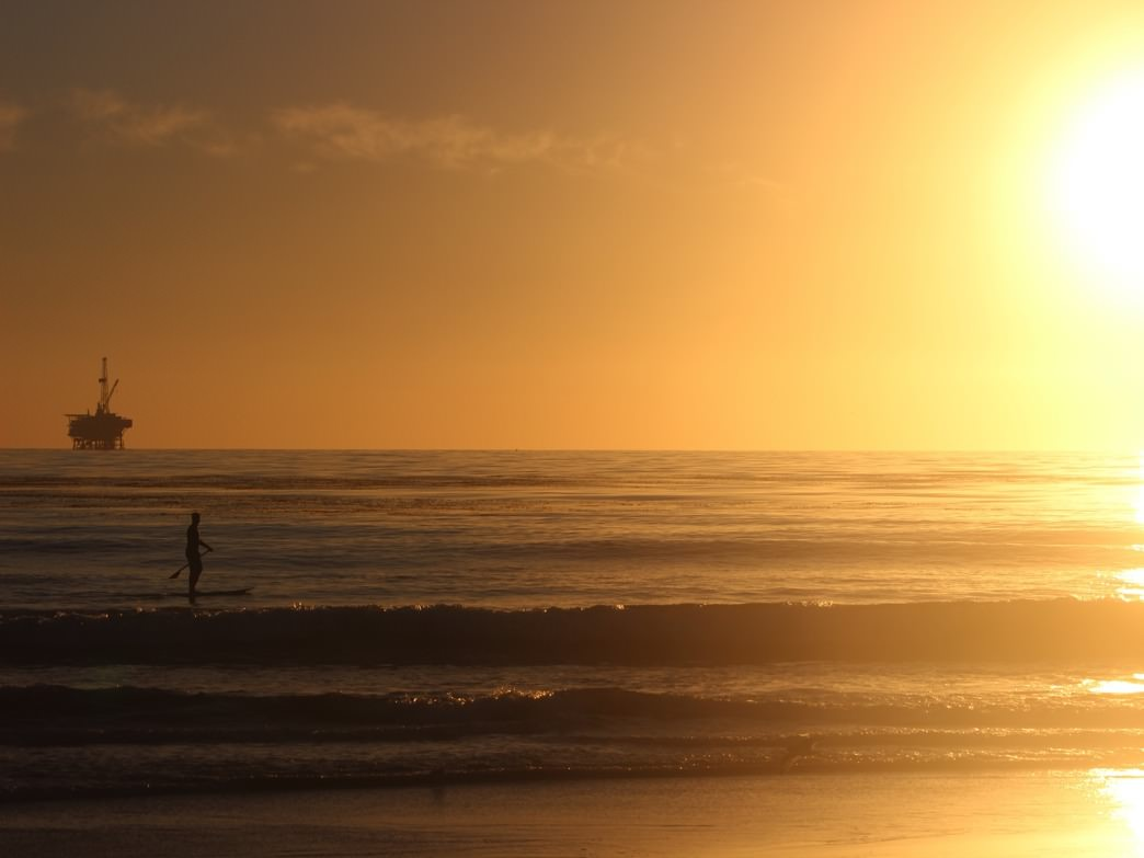 The pure golden bliss of a sunset paddle along the coast of Santa Barbara.