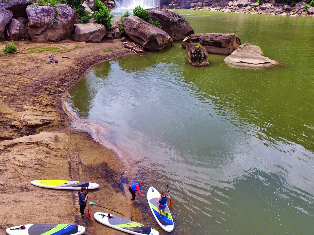 Learn how to stand-up paddleboard at Cumberland Falls Resort State Park.