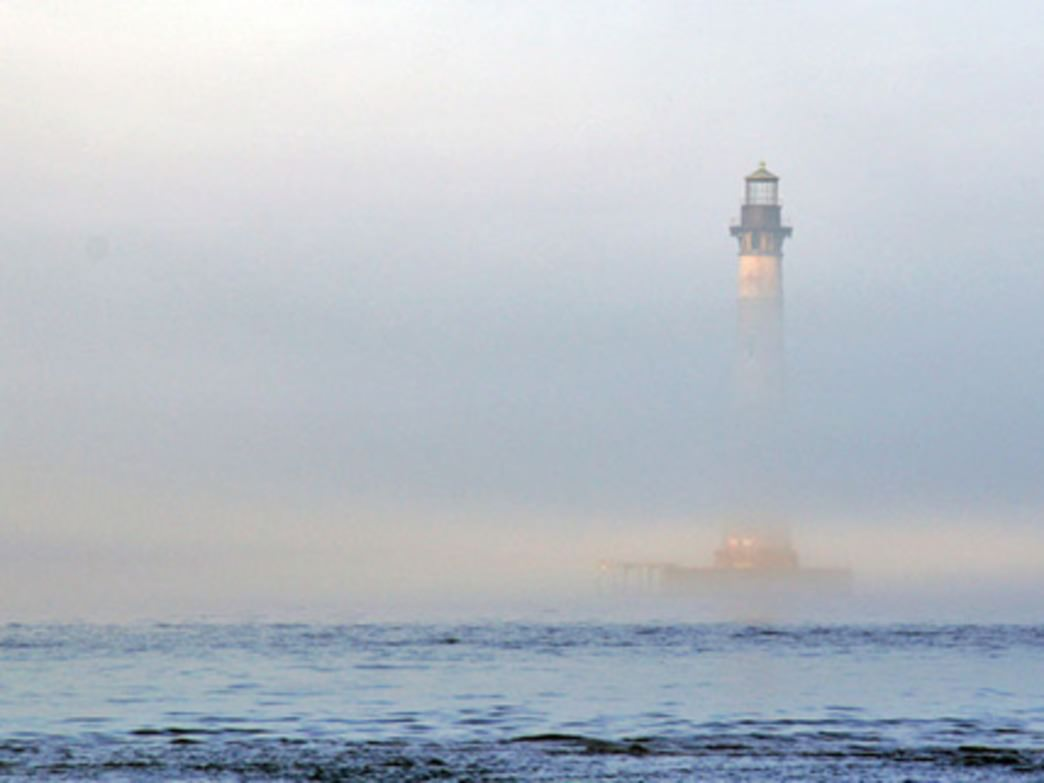The Morris Island Lighthouse emerging from the fog