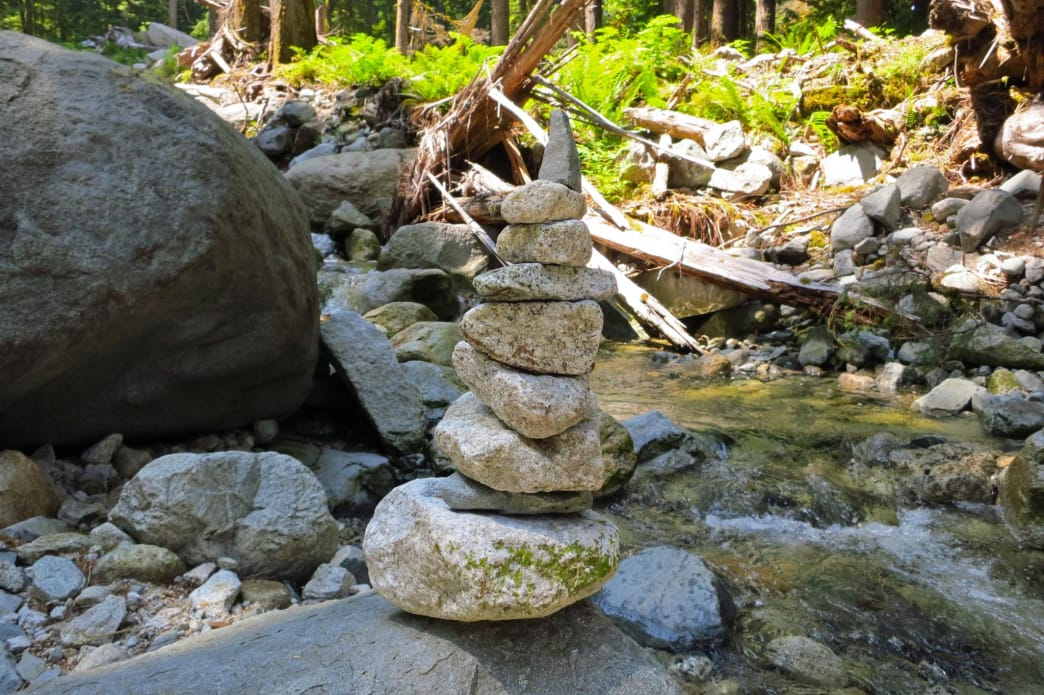 Rock piles creekside along Middle Fork Trail, Washington.