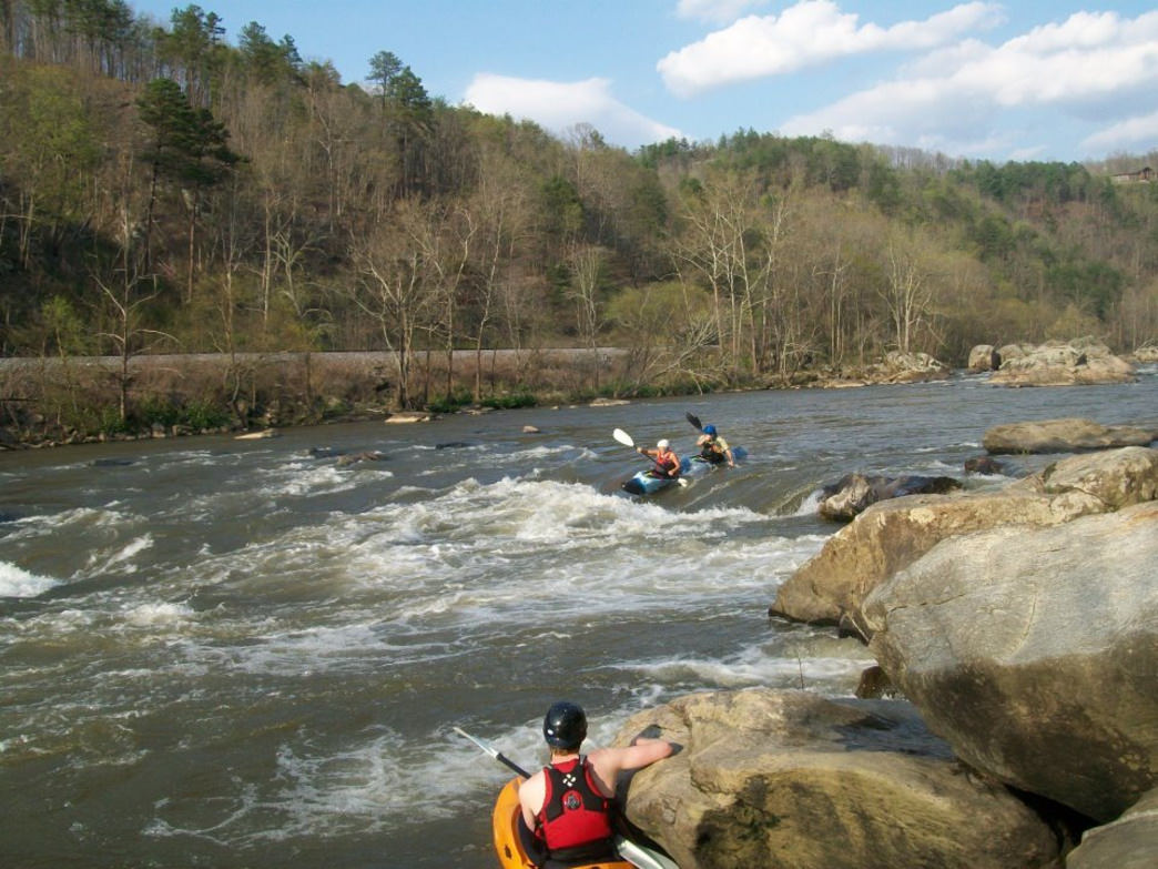 Paddlers enjoying the splashy class II rapids of the French Broad.
