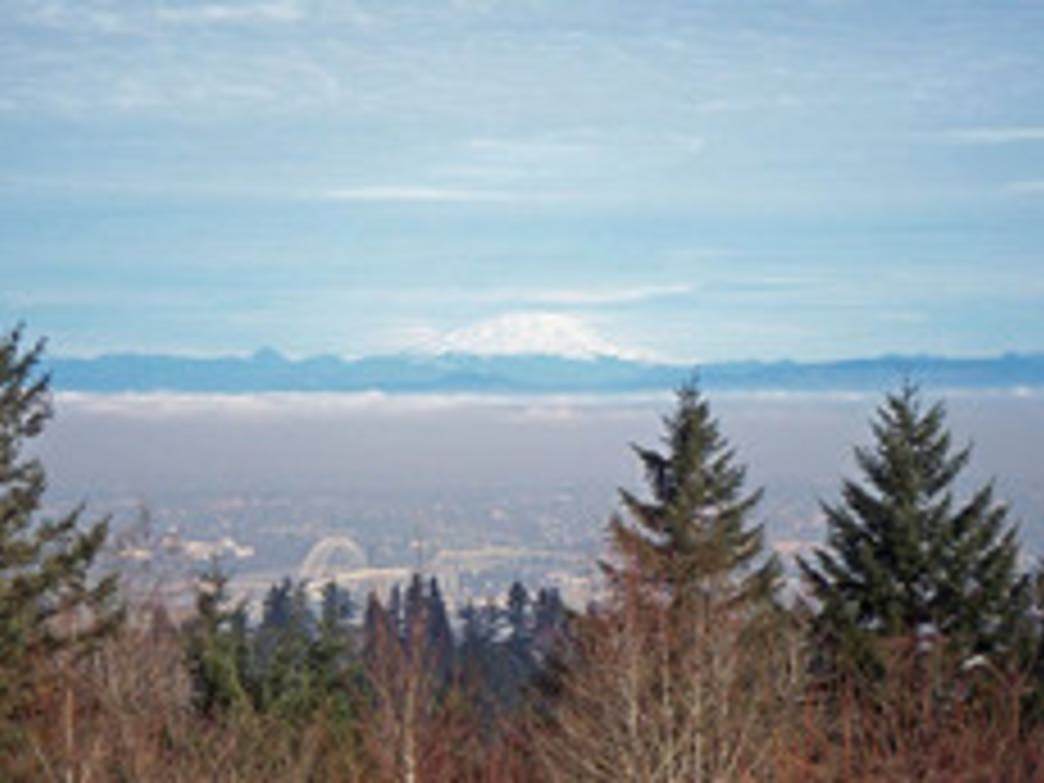 The summit of Council Crest (part of the 4T Trail) affords hikers views of Mount St. Helens and north Portland.