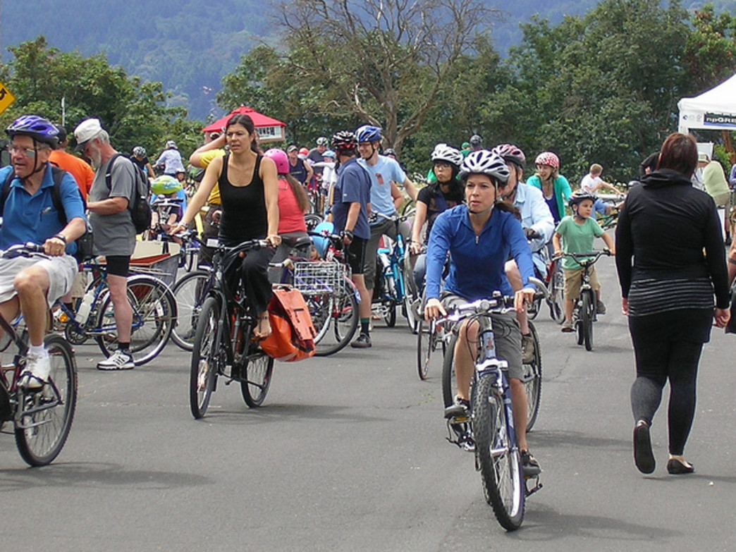 Portland is known as a bike-friendly city, thanks in part to programs such as Sunday Parkways (pictured). But it has yet to produce a bike share system.