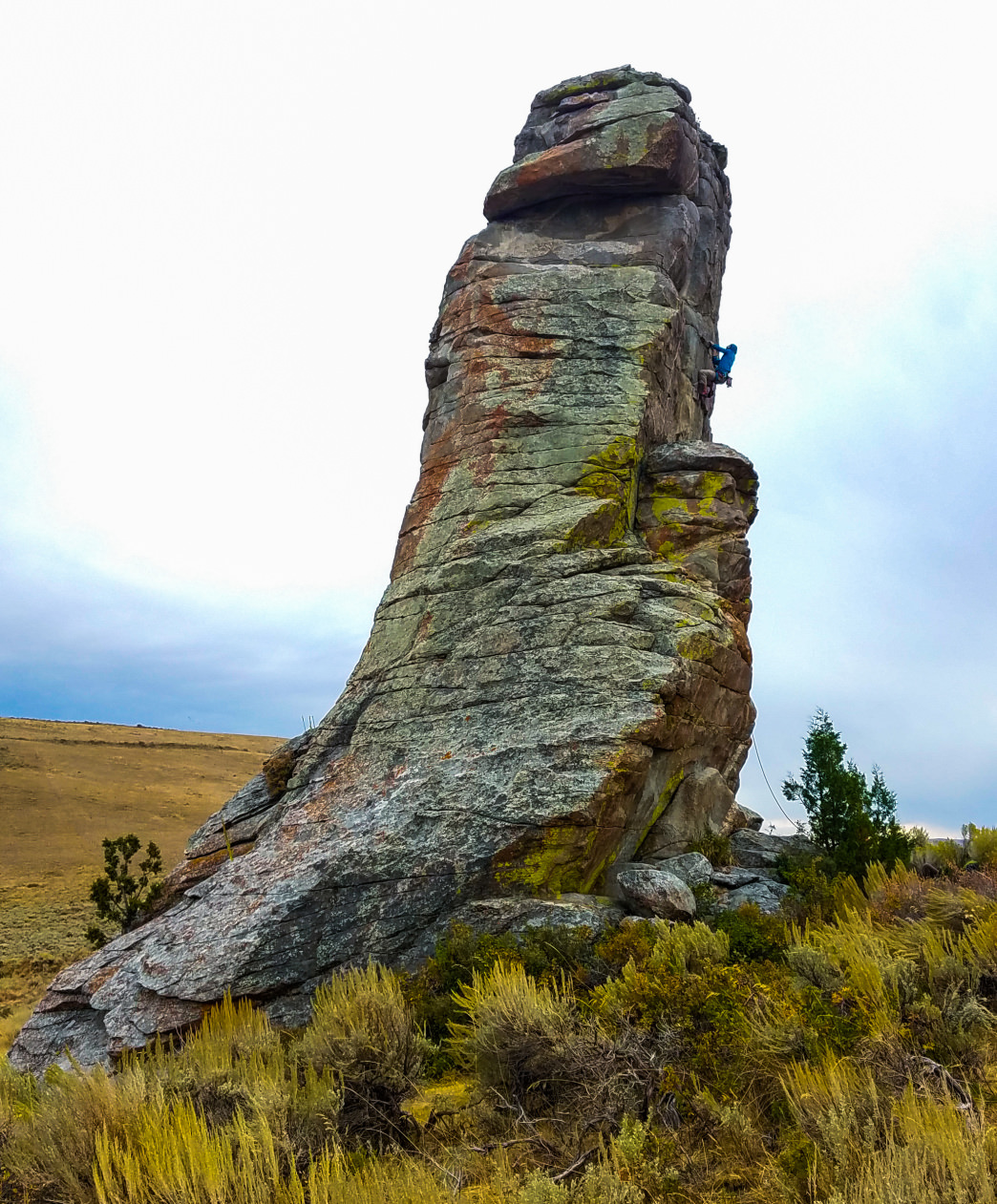 The author sending White Line Fever (5.11a PG13) on the Private Idaho formation, an isolated tower high above The City in an active cattle pasture.