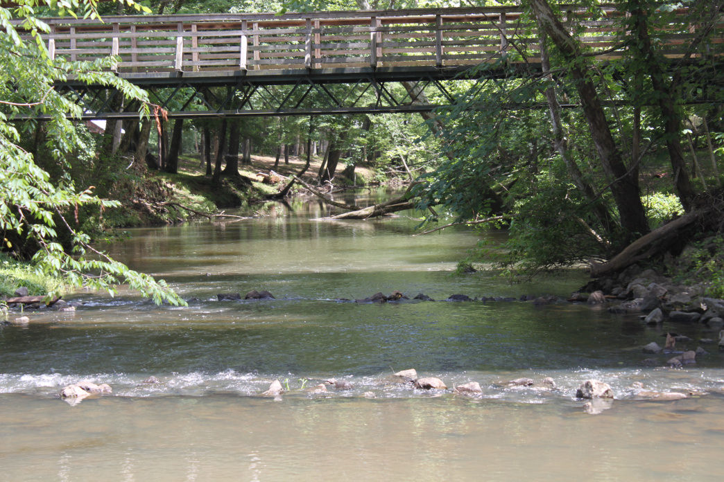 Stop and dip your toes in the cool water along the trail by Mill Creek Bridge.