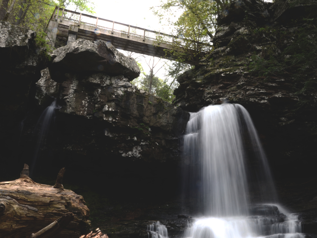 After viewing Cherokee and Hemlock Falls, cross the bridge and head down the Sitton's Gulch Trail.