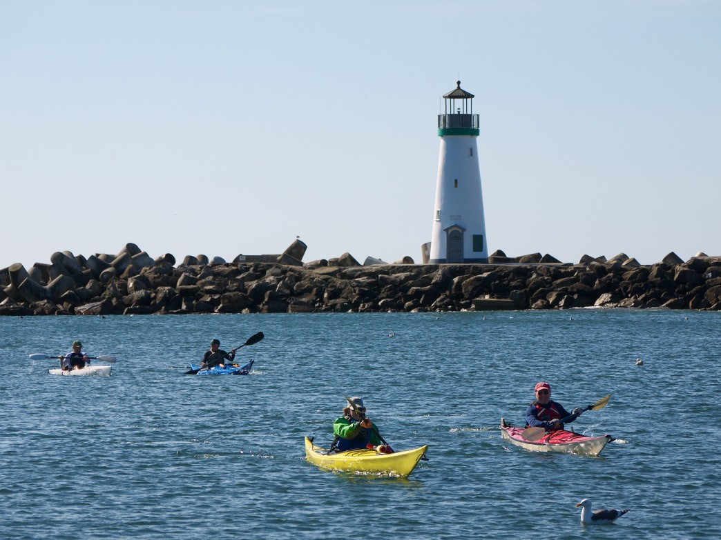 Paddlers near the lighthouse in Santa Cruz.