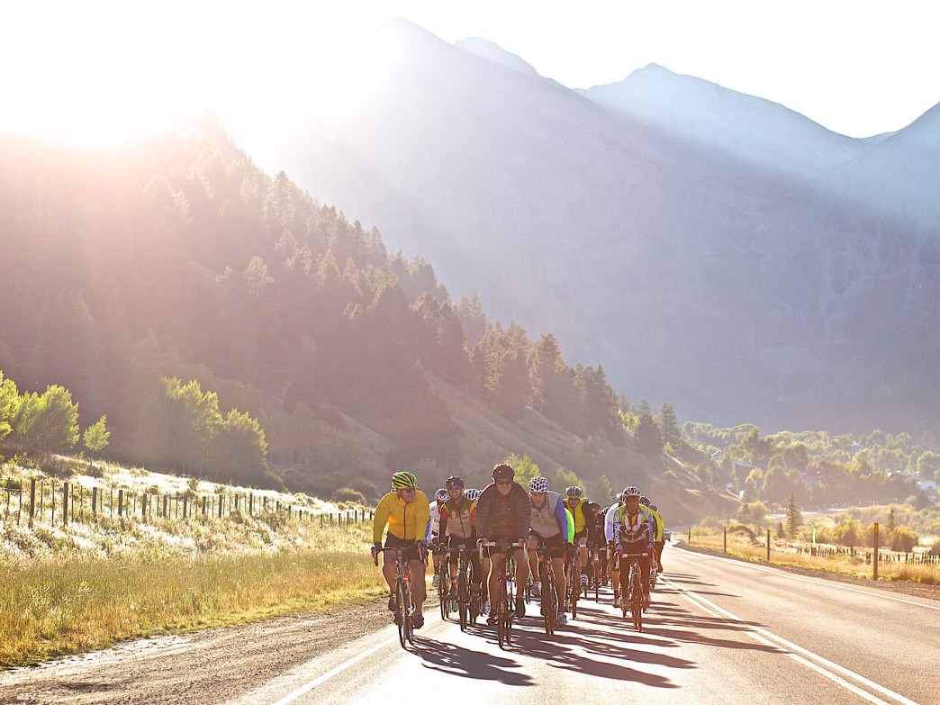 Mountains to the Desert cyclists roll out of Telluride at the beginning of the annual ride.