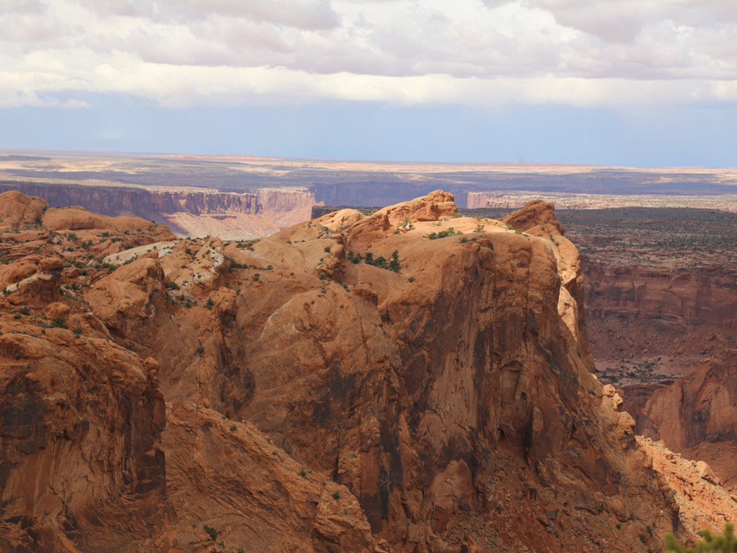 Upheaval dome juts above the expanses of Canyonlands National Park.