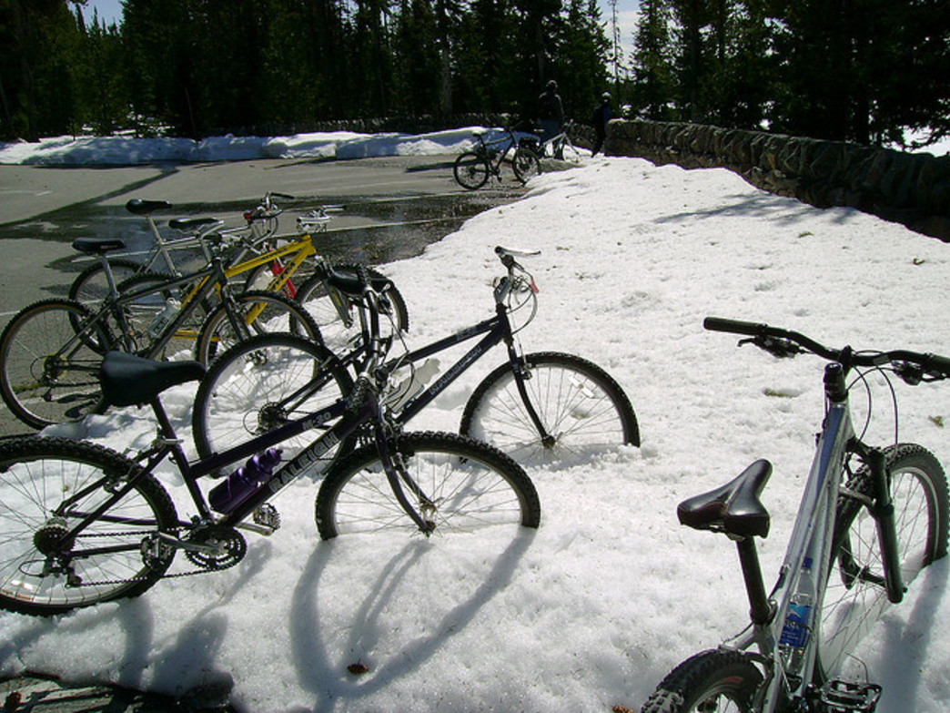Snowdrifts double as bike parking during the spring season.