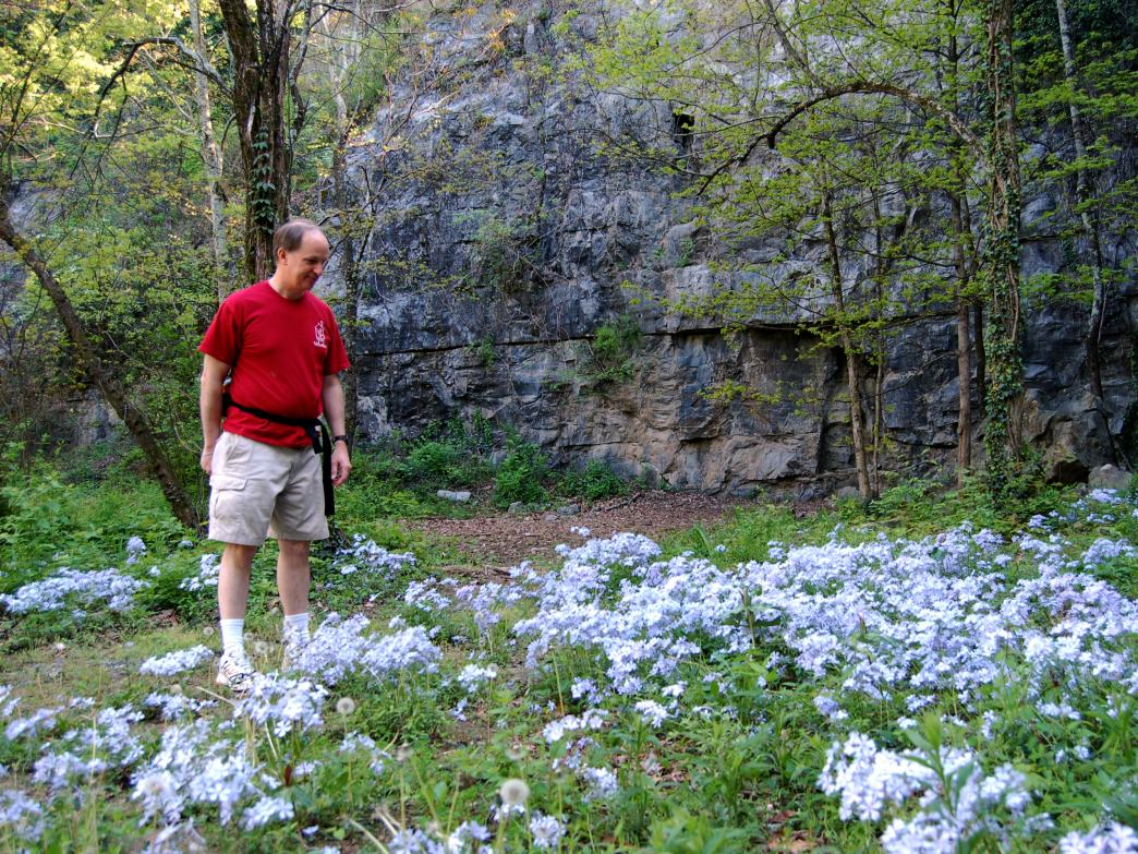 Jerry Patton admires wildflowers at Eagles Nest