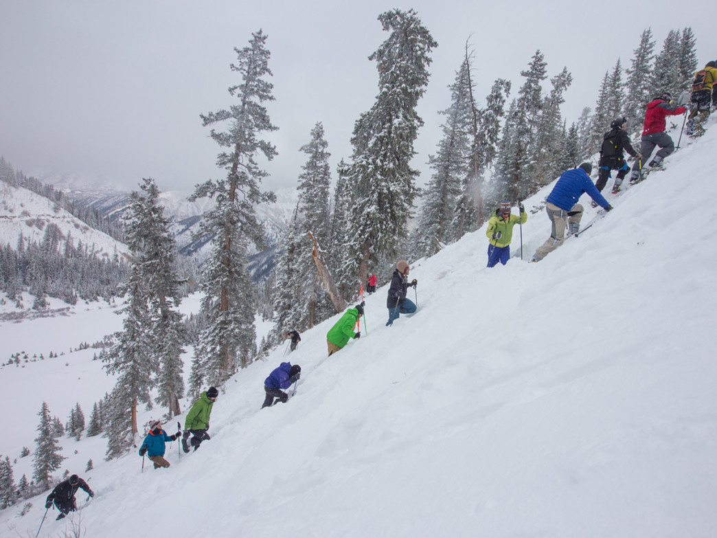 Bootpackers methodically stomp down the snow in the Highland Bowl.