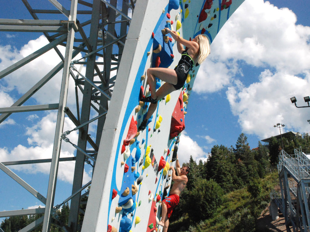 The climbing wall at Utah Olympic Park features a pool below, allowing users to climb without protection.
