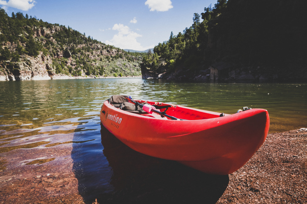 A kayak rests on the shore of Cart Creek Canyon in Flaming Gorge Reservoir, Utah.