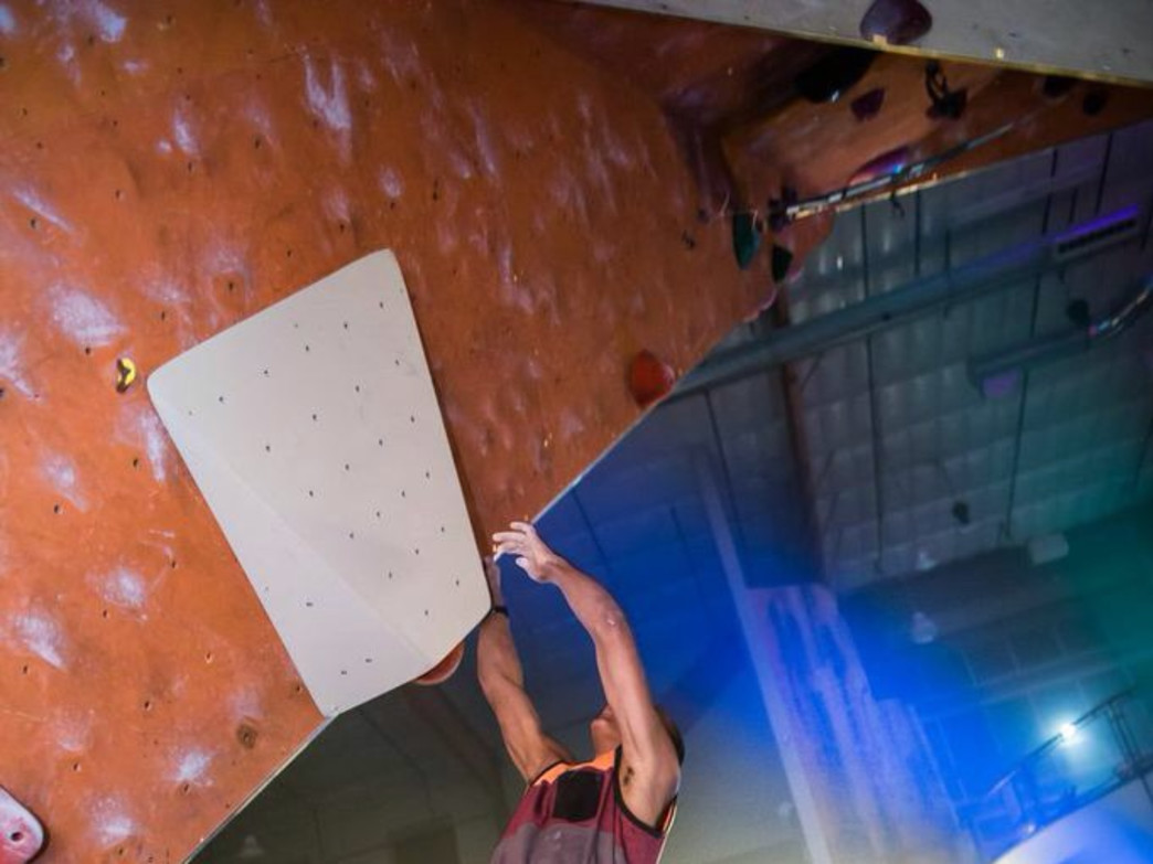 Kai bouldering in the pro's comp at Rock & Rave.