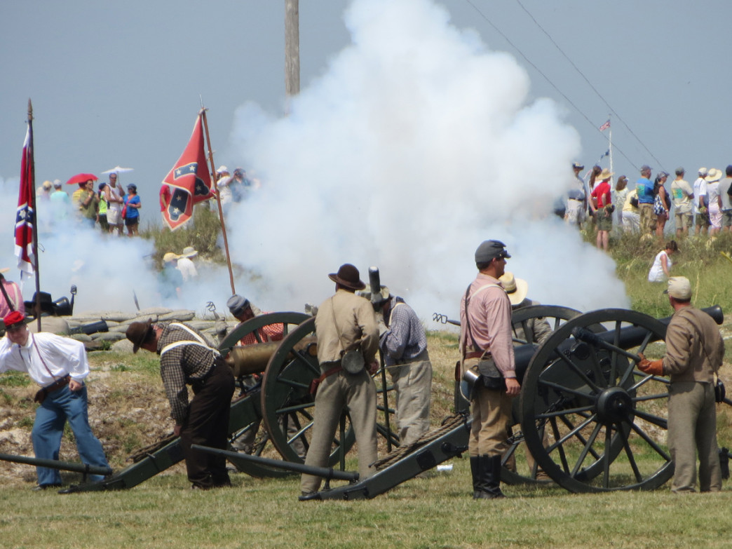 Reenactors fires a salute during the 150th anniversary of the Battle of Mobile Bay at Fort Morgan.