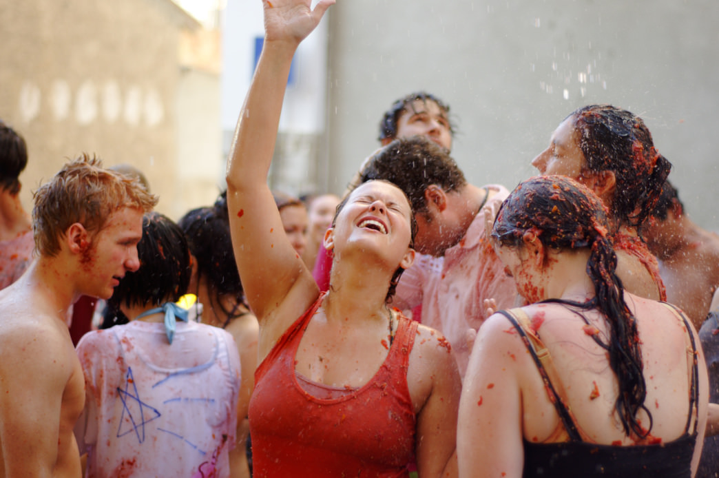 La Tomatina turns the streets and festival-goers into a tomato-coated mess.