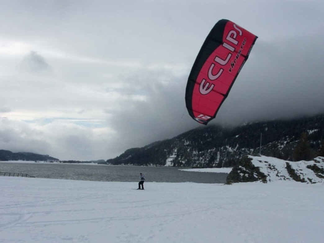 Snow kiters use the wind to propel them while they glide along the snow.
