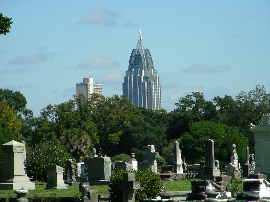 Old meets new: the spire of the state's tallest building, the RSA Tower, looks over Mobile's second-oldest cemetery, Magnolia.     Joe Cuhaj