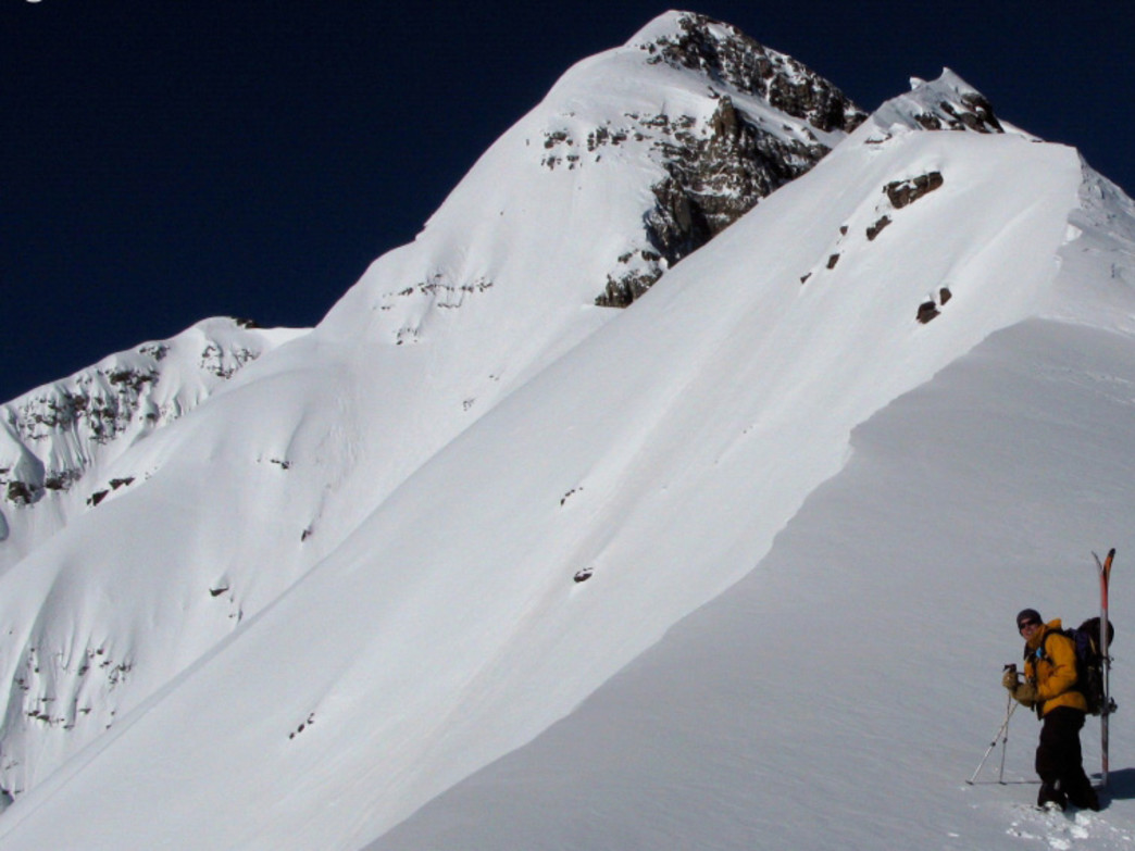 Jordan White nears the summits of Pyramid Peak.
