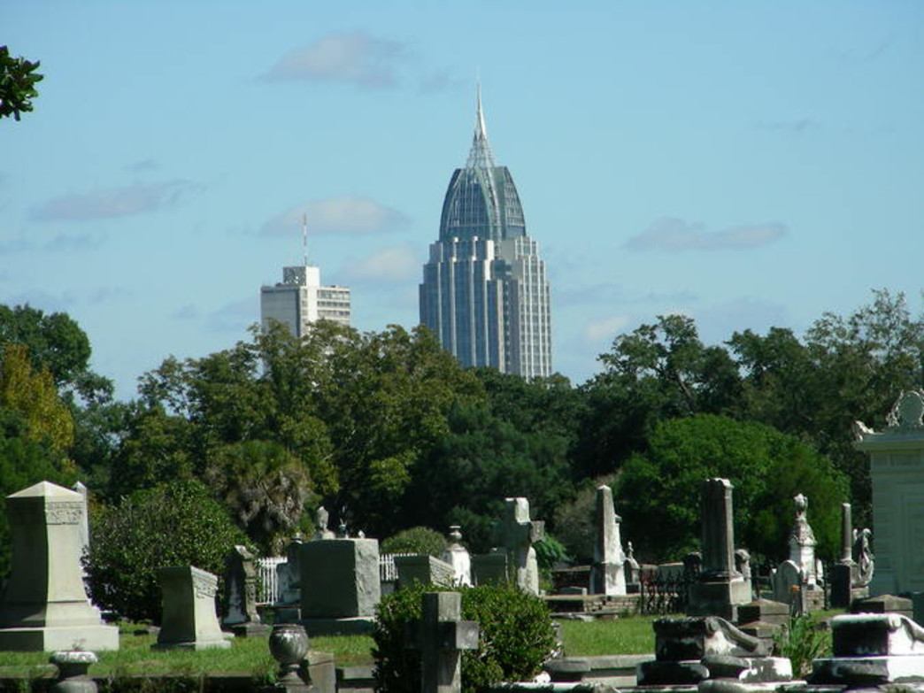 The old meets the new—the spire of the state's tallest building, the RSA Tower, overlooks the Mobile's second oldest cemetery, Magnolia Cemetery.
