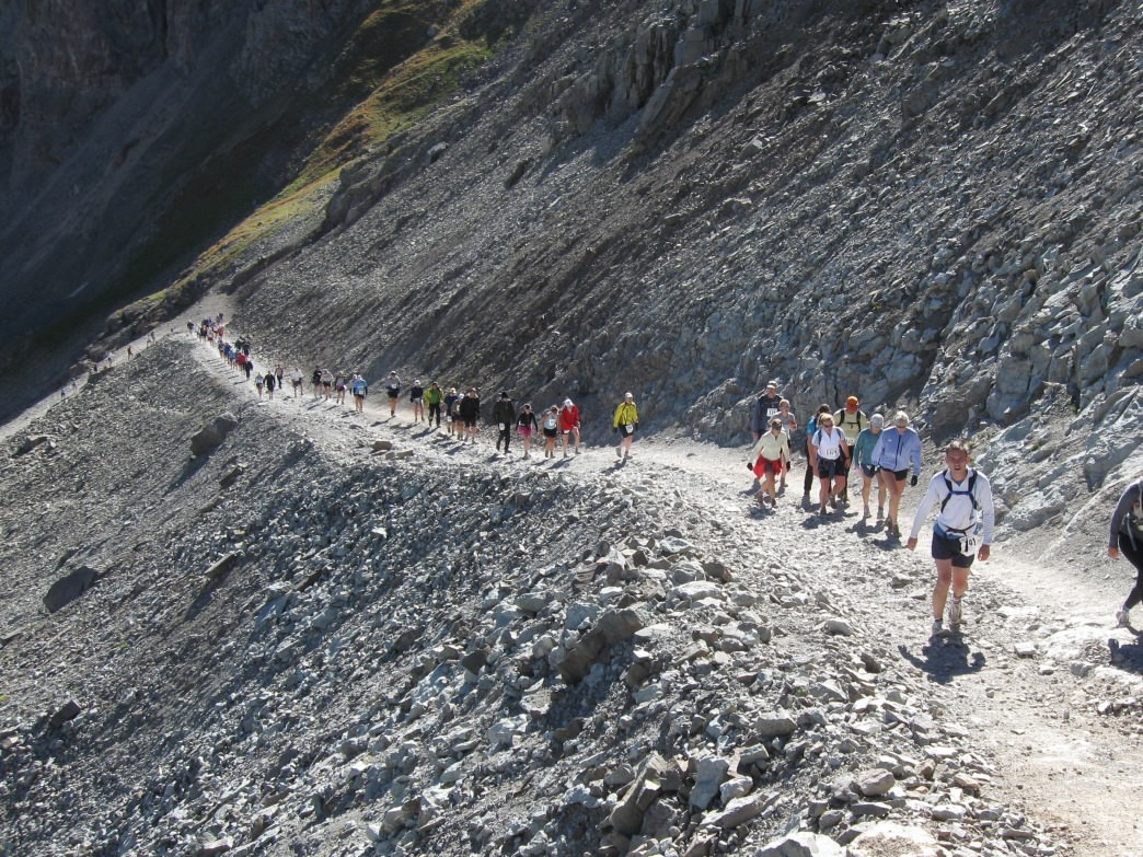 A stream of racers in the 2008 Imogene Pass Run near the top of the headwall at mile 8.8, elevation 12,100 feet.
