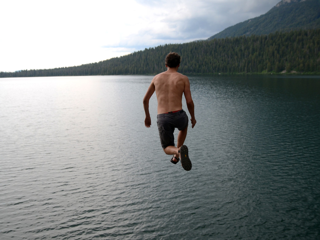 An awkward leap into the icy waters of Phelps Lake!