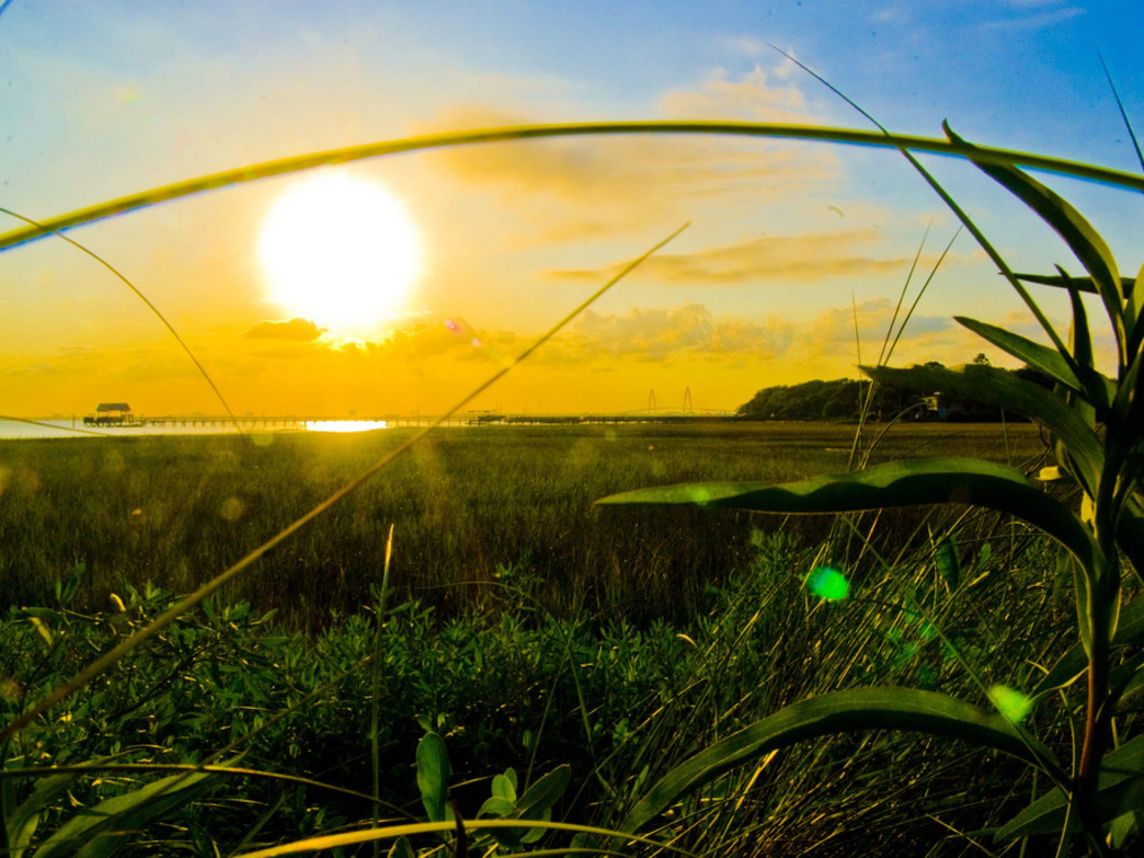 A spectacular sunset near Pitt Street Bridge is a must-do during a Charleston summer.