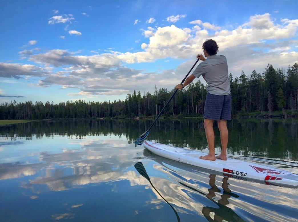 Paddling on the immaculately smooth waters of String Lake in Grand Teton National Park