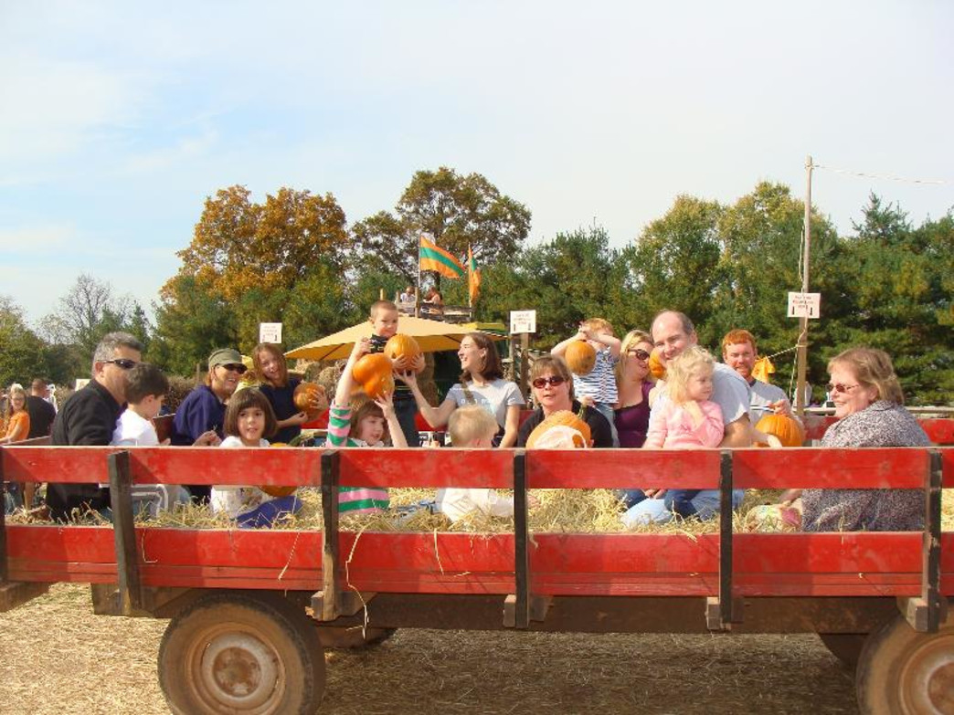 Visitors enjoy a hay ride at Freddy Hill Farms.