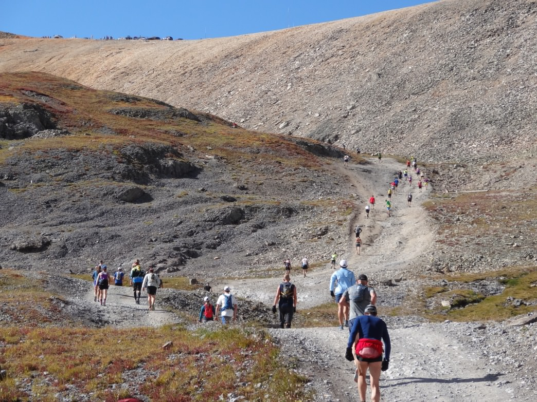 2014 Imogene Pass Run participants approach the second of four final steep climbs in upper Imogene basin, with the                 summit ridge in seemingly close range.