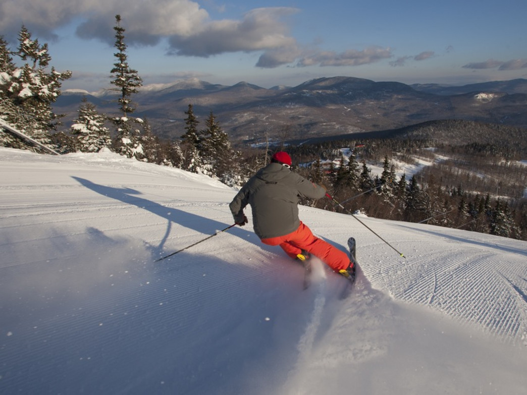 Charging down the groomers on a blue-sky day at Sunday River.
