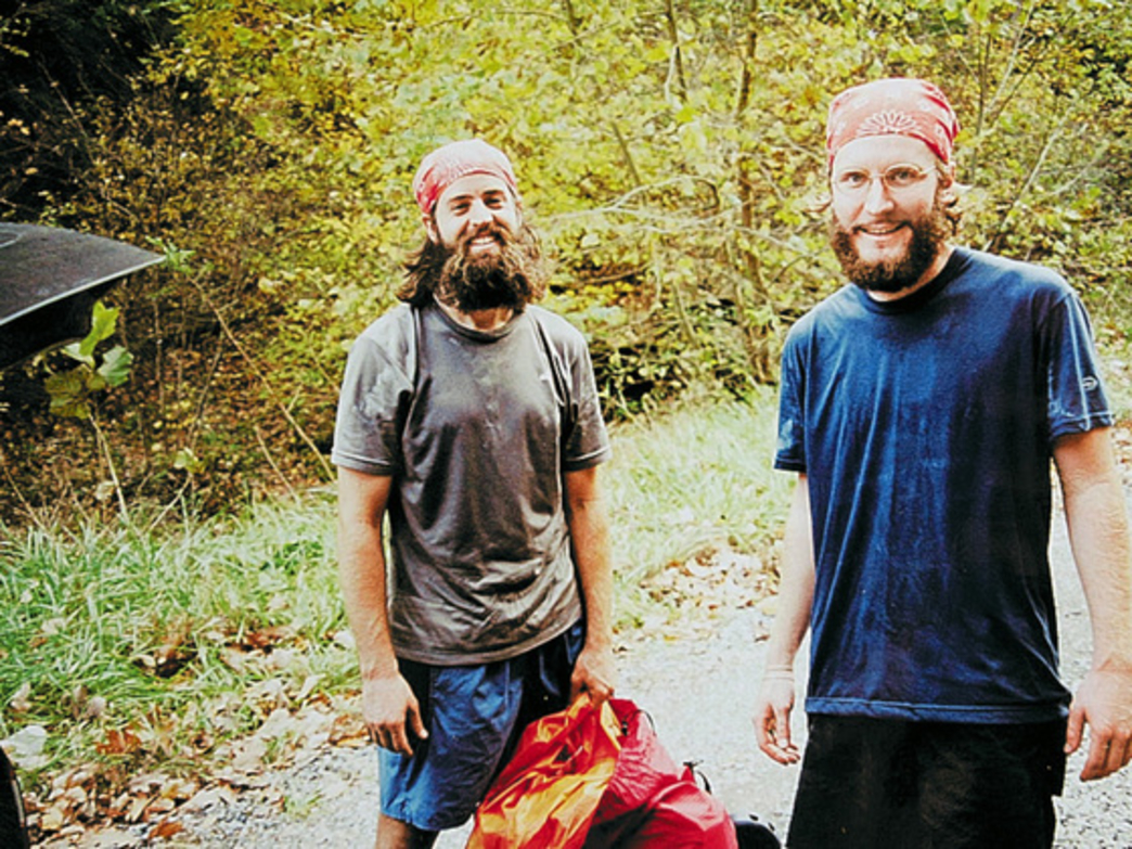Stephen Otis, left, and Colin Roberts pose for a photo at the base of Roan Mountain during their 2002 AT thru-hike