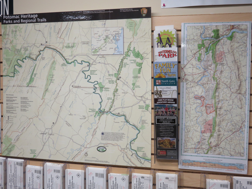 Trail maps hang from a wall in the store.