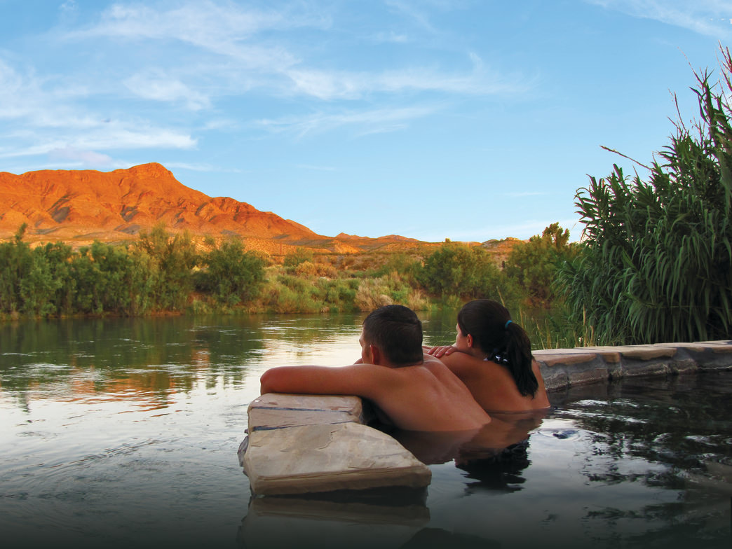 Soak your stress away and take in the views from a hot springs tub along the Rio Grande.