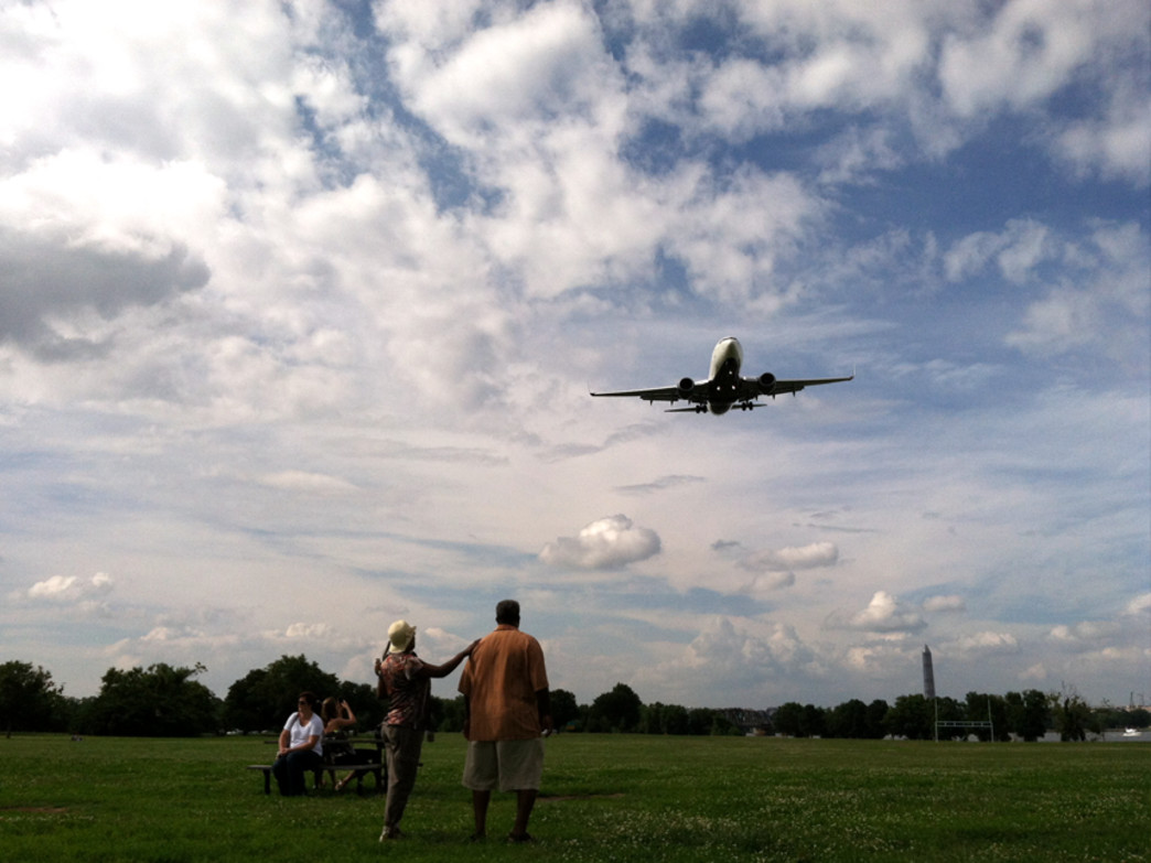 Two peas watch flights take off from Reagan National Airport at Gravelly Park