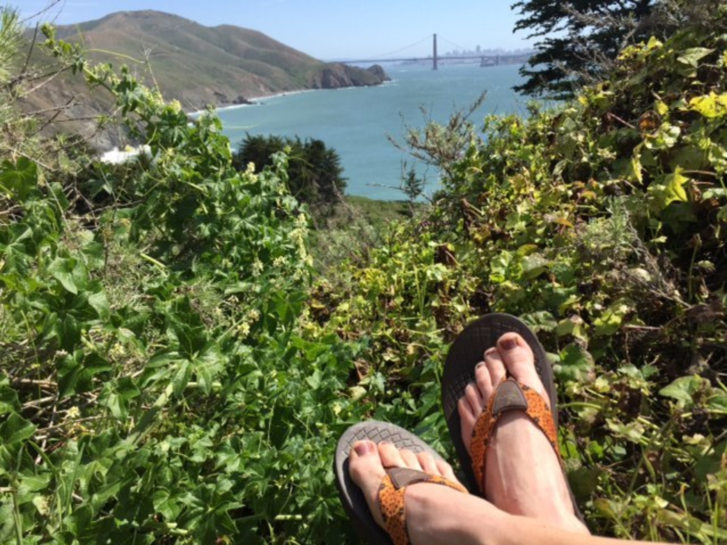 Relaxing after a trail run in the Marin headlands, with a view of the Golden Gate Bridge and the San Francisco skyline in the background.