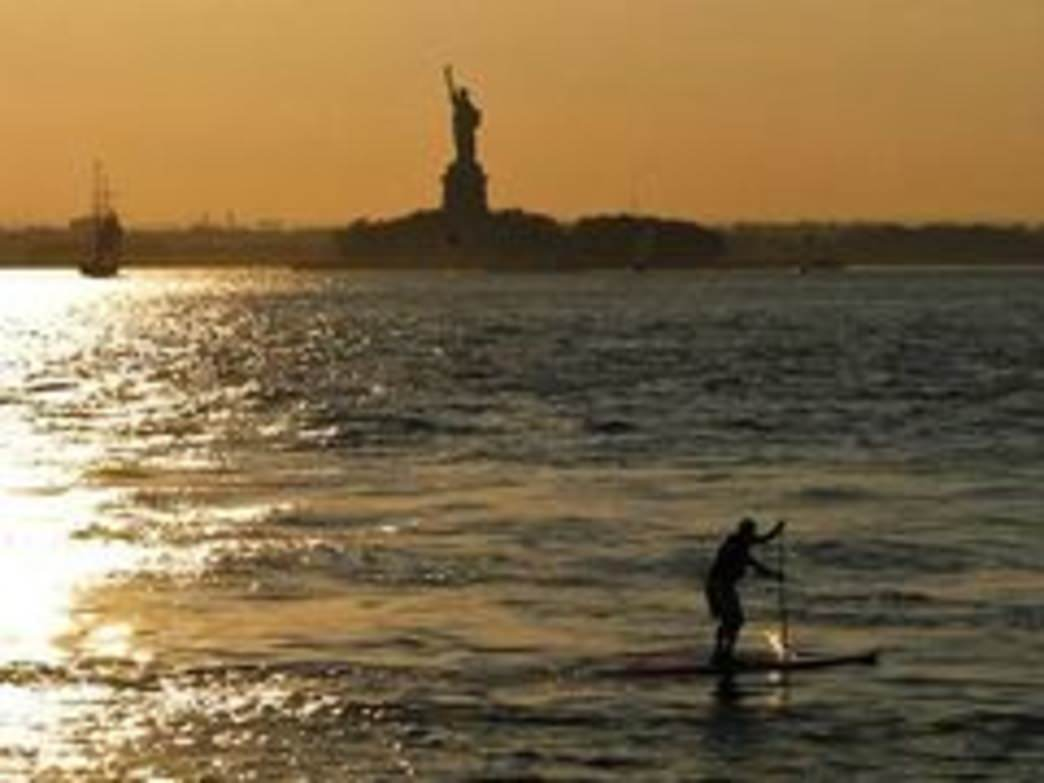 Enjoying a sunset paddle with Lady Liberty.