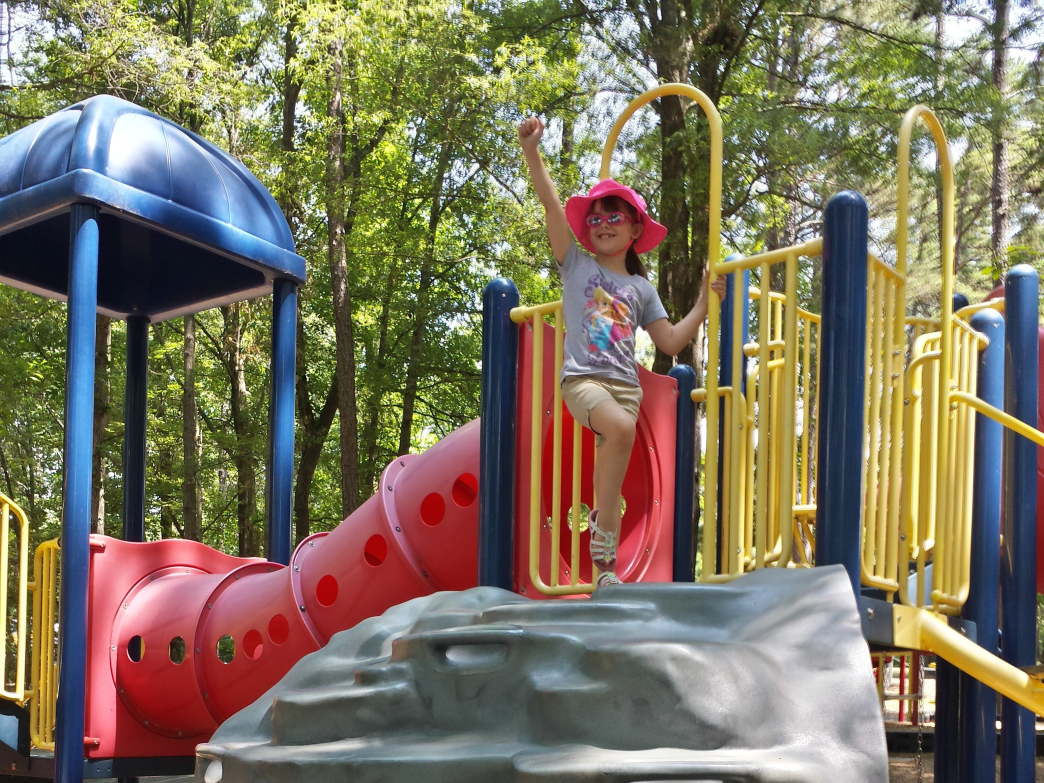 kids can climb, swing, and slide the large playground area at Cane Creek Park