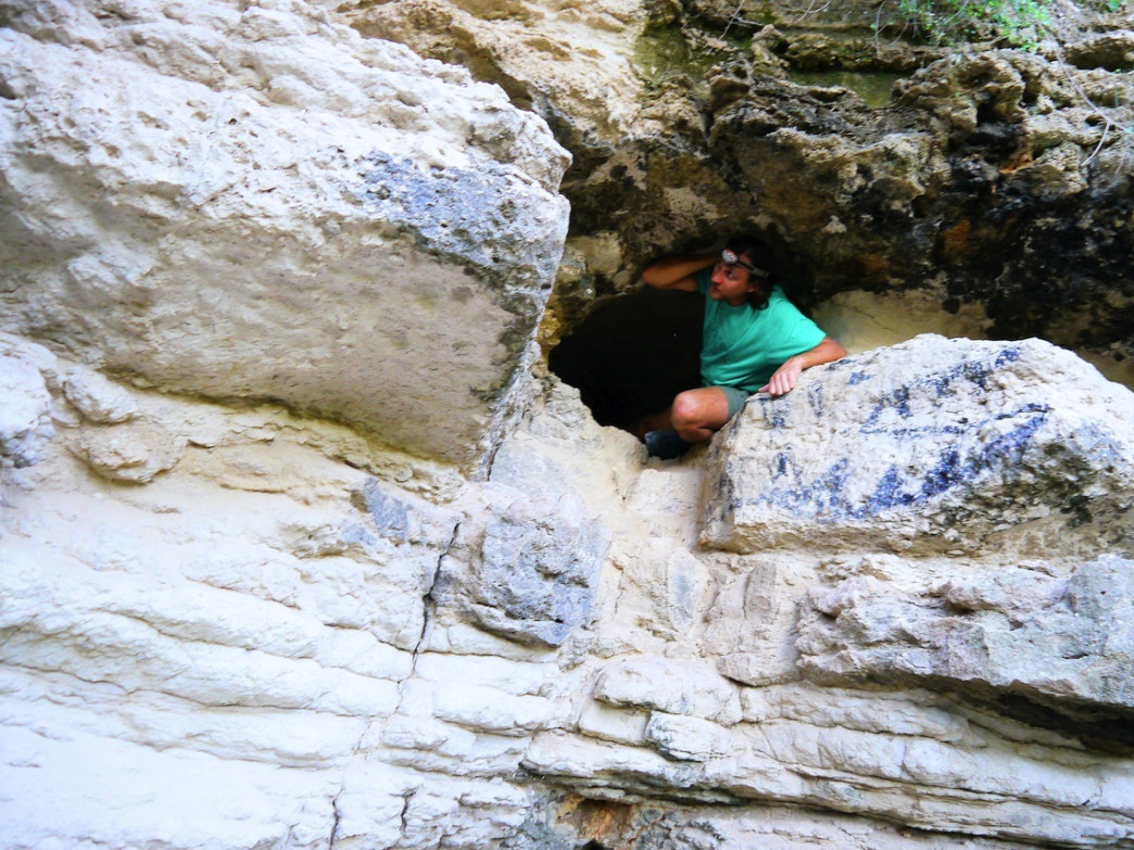 Author Dave Brown exits Bullet cave's cliff-face opening