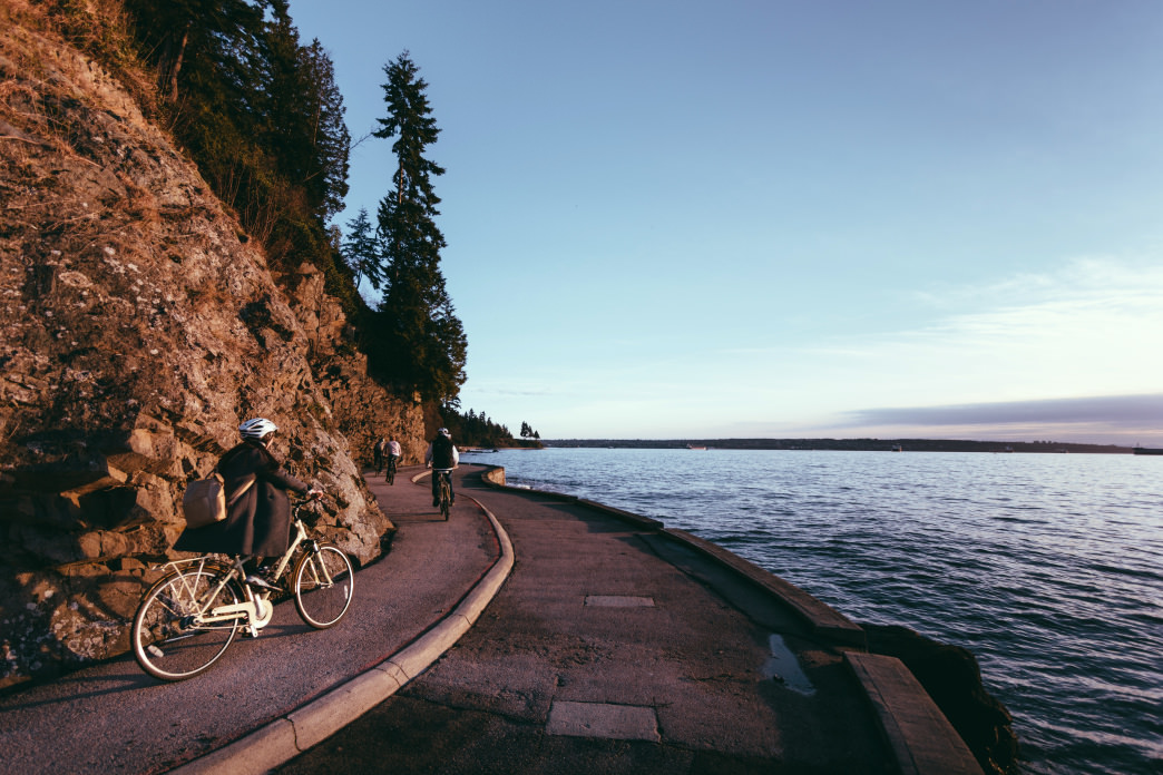Cyclists can ride just along the surf from the Seawall in Stanley Park.
