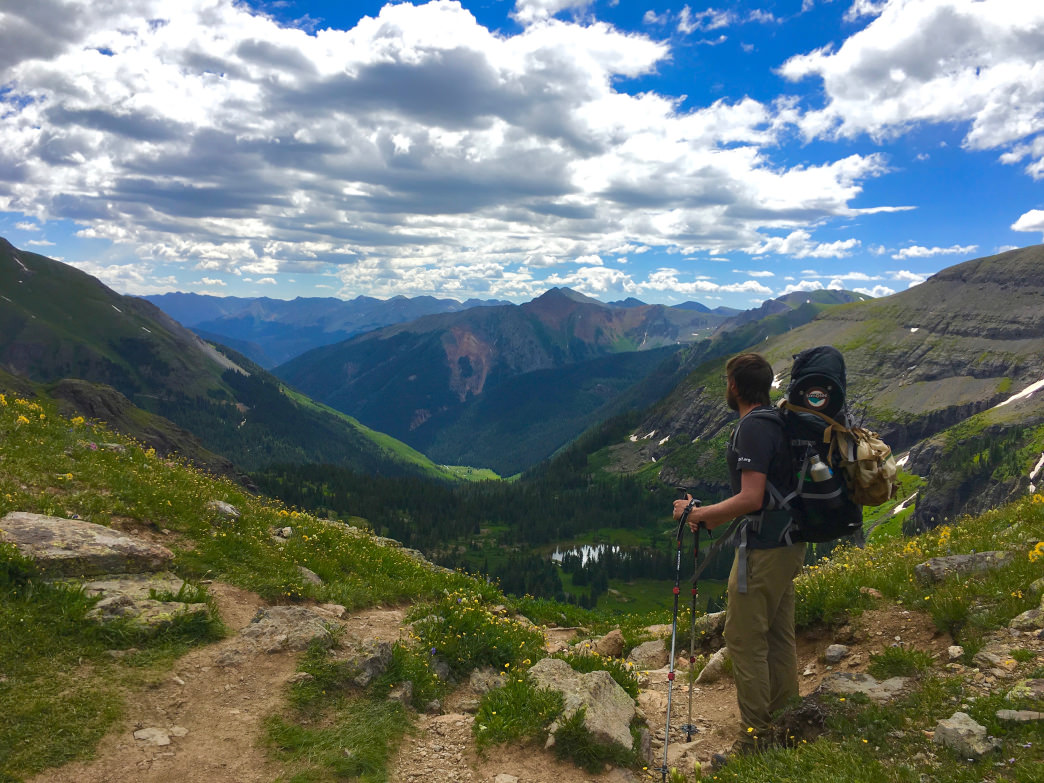 A backpacker pausing to reap the rewards of the challenging climb up to Ice Lake.     Aaron Hussmann