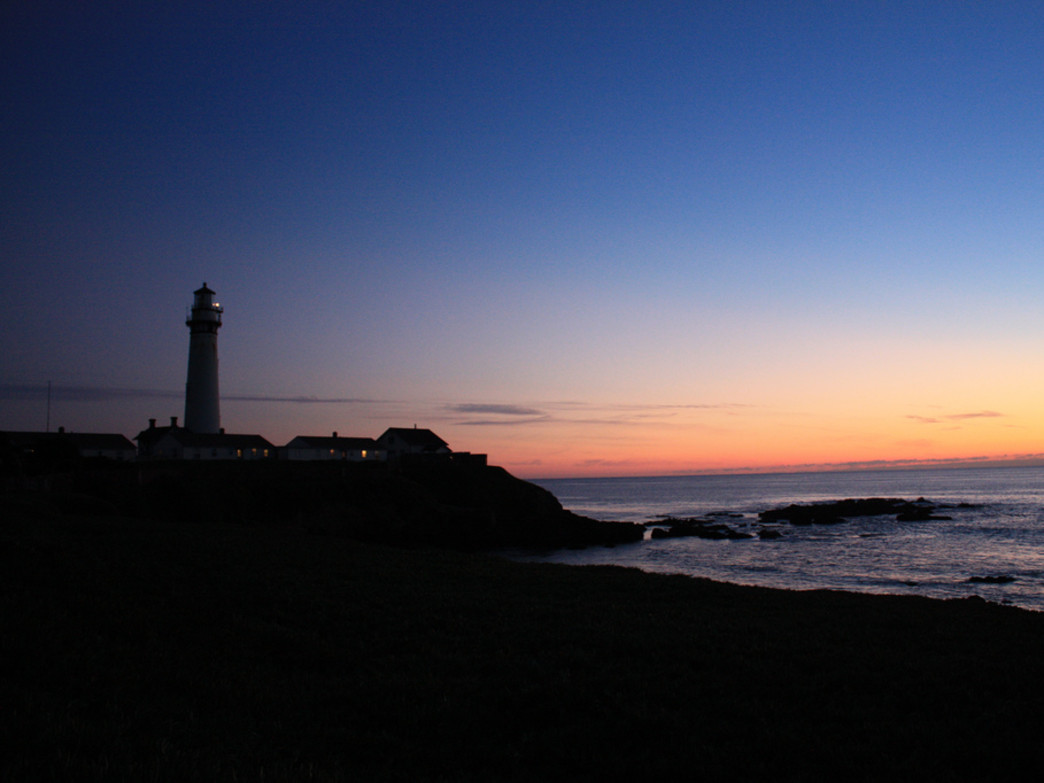 The 115-foot Pigeon Point Lighthouse in Pescadero stands out against the sunset.