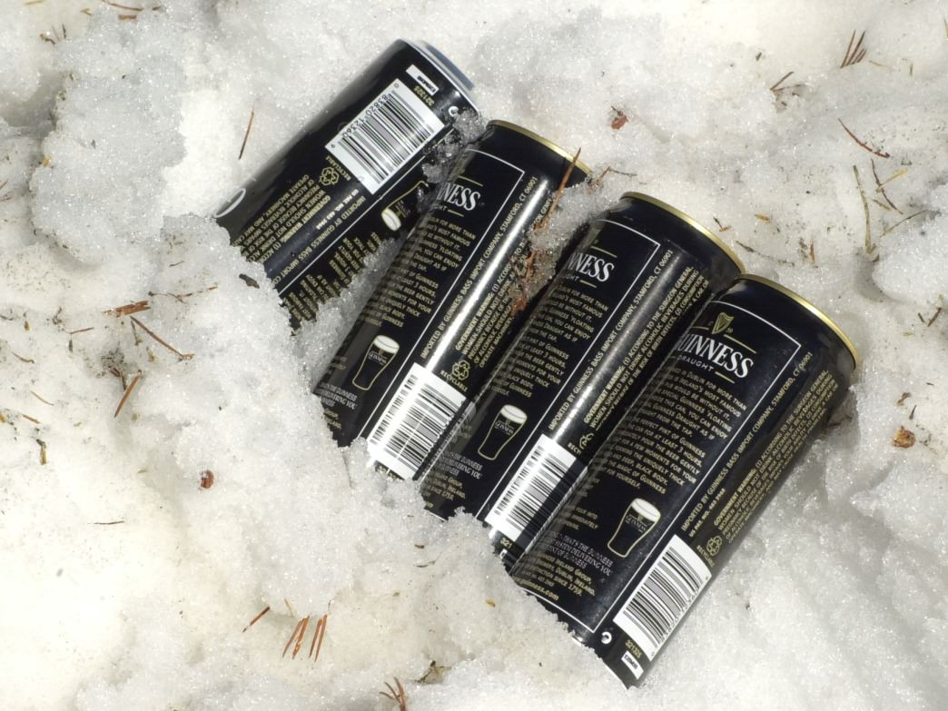 Snowbanks provide a way to keep your favorite beverage cool for the toast after bagging a peak.