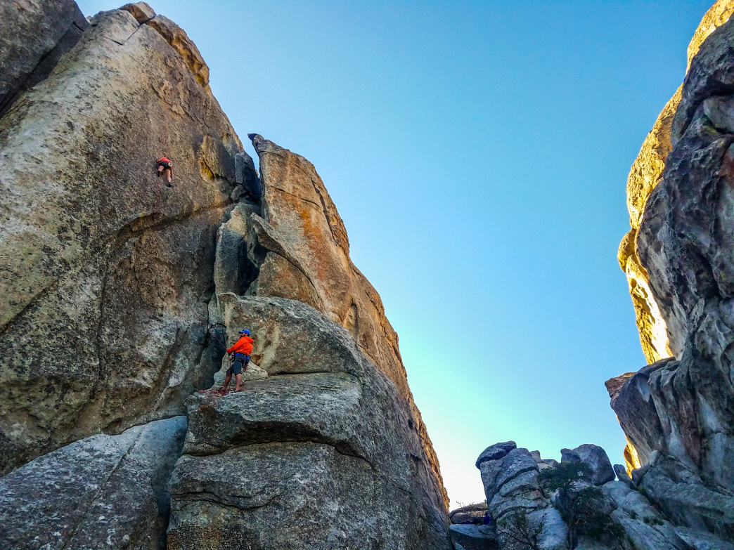 Schyler finds out what patina climbing is all about on The City's ancient granite faces. A few of these spires are part of the 2.5-billion-year-old Green Creek Complex—some of the oldest exposed rock in North America.